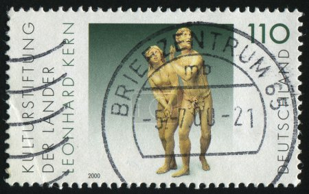 Photo pour GERMANY- CIRCA 2000: stamp printed by Germany, shows The Expulsion from Paradise, sculpture by Leonhard Kern, circa 2000 - image libre de droit