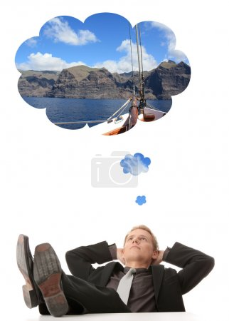 Young businessman thinking about vacations