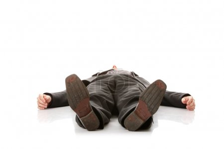 Businessman laying down in a suit
