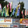 A variety of carnival food vendors on the midway...
