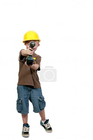 Foto de Un niño pequeño vestido para un trabajo de construcción - Imagen libre de derechos