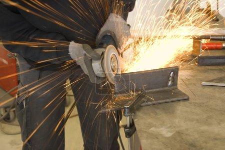 Steel worker grinder