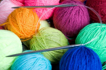 Colorful balls of wool and knitting needle...