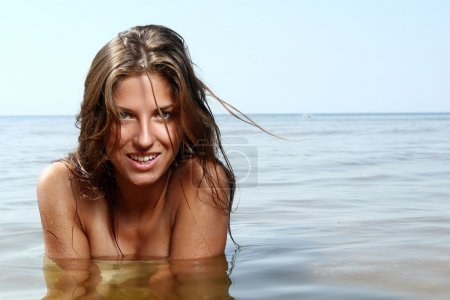 Sexy and beautiful woman in the sea water