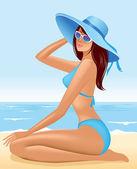 Beautiful girl sitting in hat on sea beach