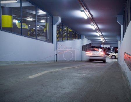 Traffic in underground parking garage. Motion blur...