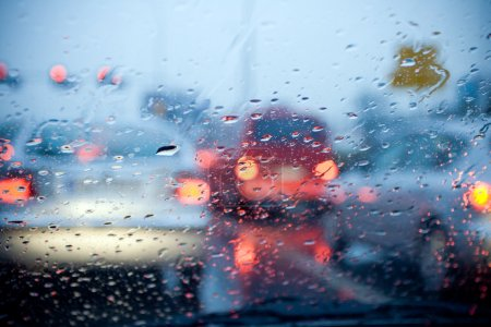 Car driving in a rain storm background