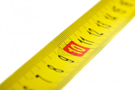 Close-up shot of yellow metal measurement tape