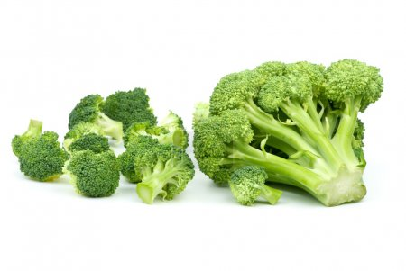 Photo for One big and few small broccoli pieces isolated on the white background - Royalty Free Image