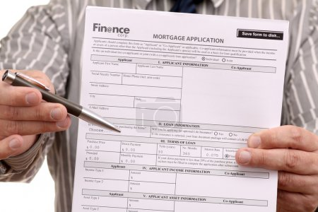 Photo for Please fill this Mortgage Application Form - Royalty Free Image