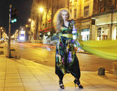 "Постер, картина, фотообои ""Elegant woman on city street at night"""