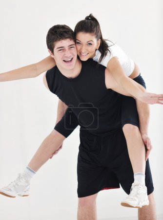 Happy young couple fitness workout and fun