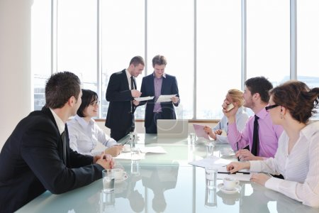 Group of business at meeting
