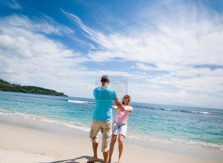 Photo for Couple having fun at seaside - Royalty Free Image