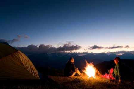 Photo for Couple tent camping in the wilderness - Royalty Free Image
