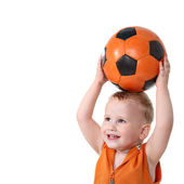 Little boy holding soccer ball