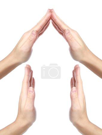 Photo pour Maison faite de mains isolées sur fond blanc - image libre de droit