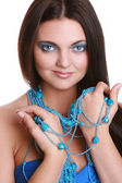 Fashionable woman with blue beads
