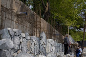 Construction wall of natural stone