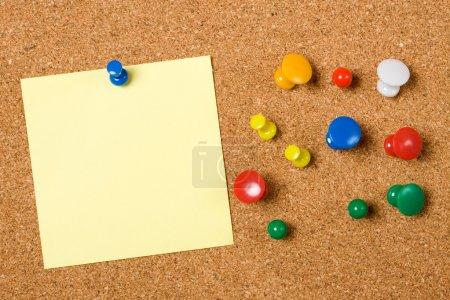 Photo for Blank paper note and office pins on cork board - Royalty Free Image
