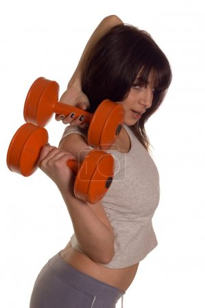 Photo for Muscular builder woman training his body with dumbbell - Royalty Free Image