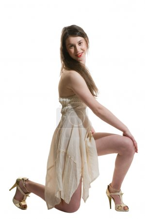 Photo for Cute young adult woman kneeling on white - Royalty Free Image