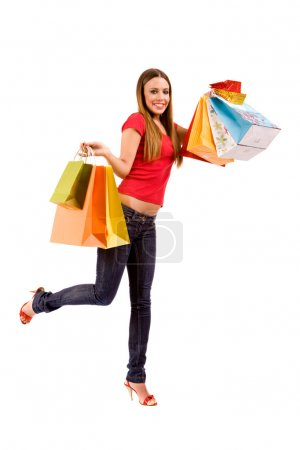 Attractive shopping girl with colorful bags