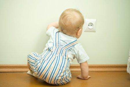 Child near the socket