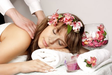 Photo for Beautiful woman on massage table with flower in hair - Royalty Free Image