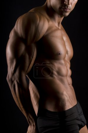 Photo for The male body on black background. - Royalty Free Image