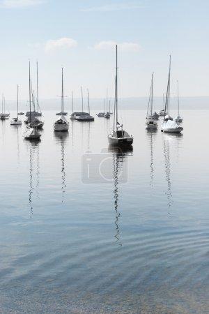 Photo for Moored Sailboats on a Calm Bavarian Lake - Royalty Free Image