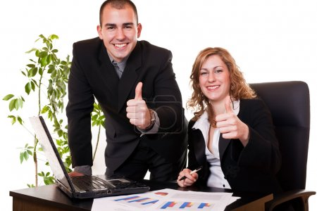 Business colleagues with thumbs up