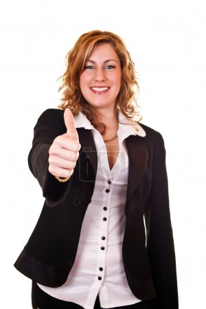 Smiling businesswoman holding thumb up