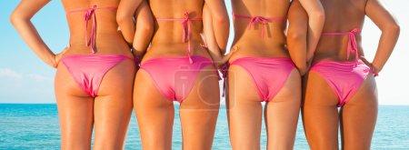 Girls back on beach