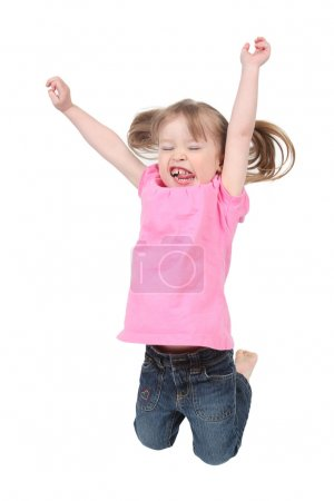 Adorable little girl jumping in air. isolated on