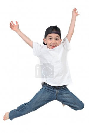 Photo for Little boy jumping on isolated white background - Royalty Free Image
