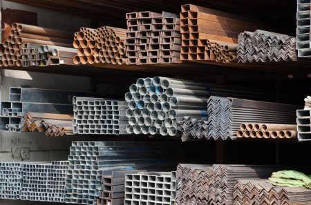 Photo for A series of different sizes metal pipes on shelf - Royalty Free Image