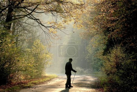 Older man in autumn forest