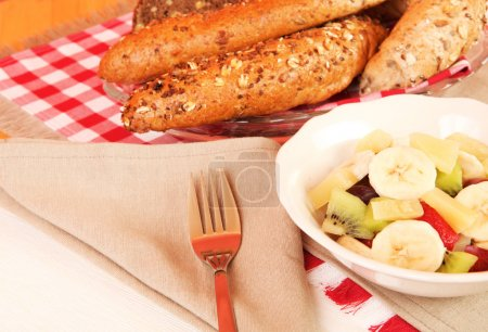 Photo for Healthy breakfast consisting of a fruit salad and cereal bread - Royalty Free Image