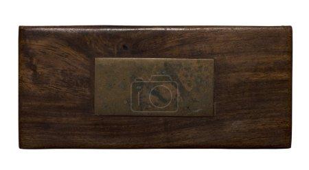 Photo pour Panneau en bois brun avec plaque en laiton vieilli - image libre de droit