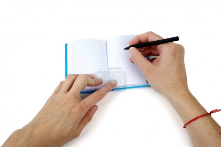 Hand writing on a small notebook