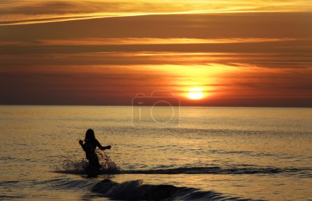 Girl silhouette at sunset