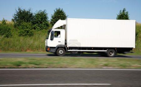 White truck speeding on freeway