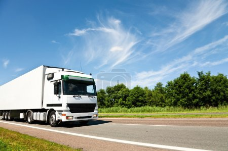 Photo for Truck driving on country road - Royalty Free Image