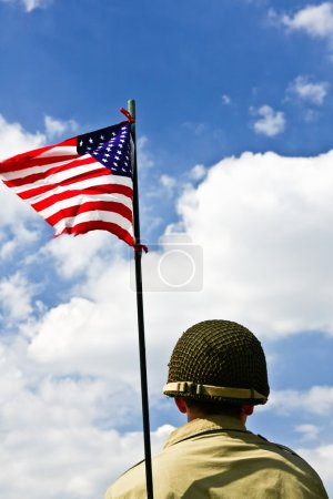 Soldier and American flag