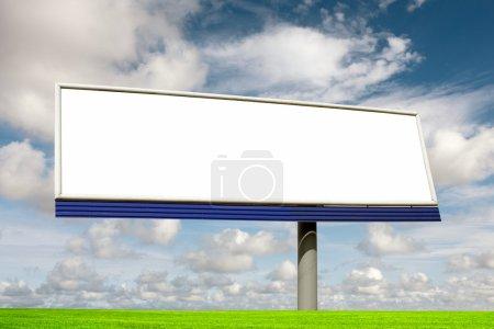 Blank bilboard in a green field