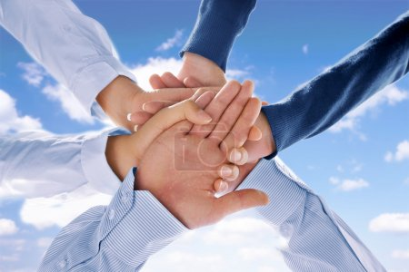 Photo for Close up view of hands getting together on blue background - Royalty Free Image