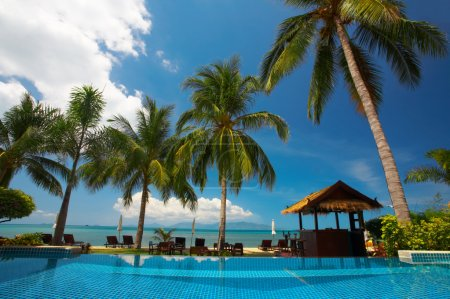 Photo for View of tropical resort swimming pool scene early in the morning - Royalty Free Image