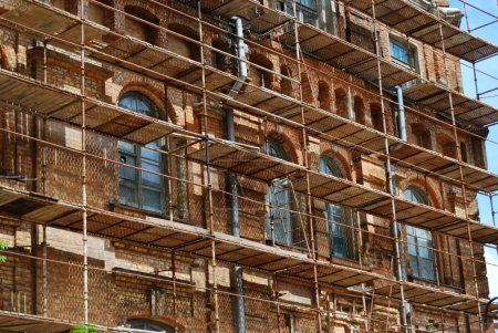 Photo for Scaffolds round an old brick building - Royalty Free Image