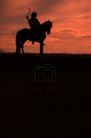 Photo for Horsemen riding on the sunset vertical - Royalty Free Image